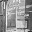 Photo:view of a shop selling horse meat in Harrow Road, 1953