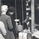 Photo:women shoppers queueing at a greengrocers in Harrow Road, c1955]